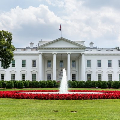 White House in spring with flowers and fountain